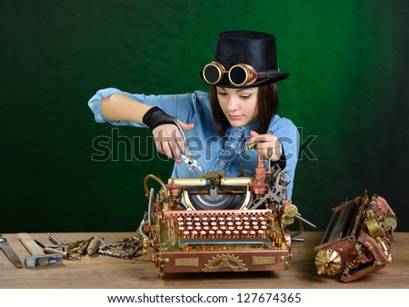 Steam punk girl repairing typewriter. - stock photo