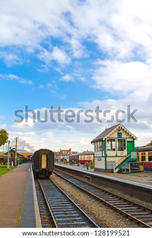 steam railway platform and station buildings - stock photo