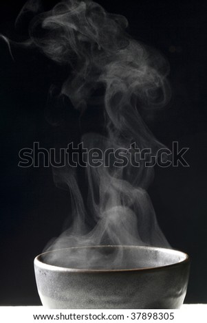 Steam rises from the rice which has been just cooked. - stock photo