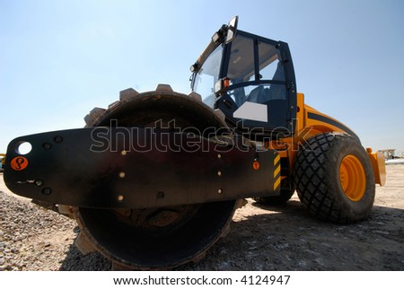 steam-roller on  background of  dark blue sky - stock photo