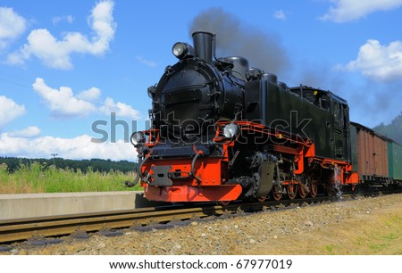 Steam train approaching station of Garftitz on island Rugen, Northern Germany - stock photo