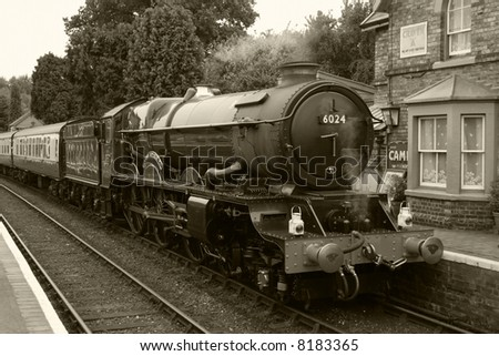 steam train in black and white - stock photo