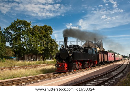 Steam Train Leaving a Station - stock photo