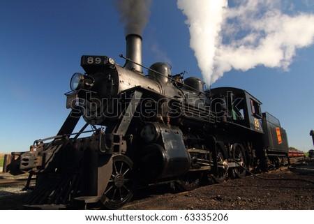 Steam train outside work bay Strasburg Pennsylvania - stock photo
