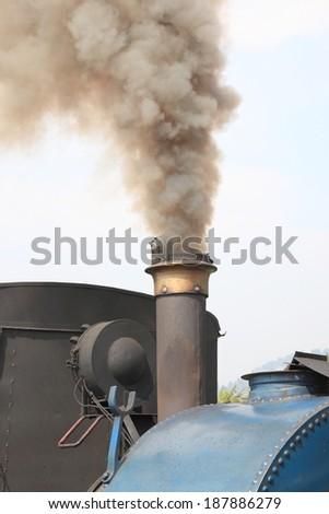 Steam train venting steam - stock photo