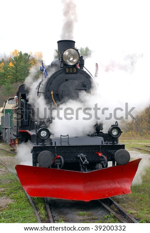 Steam train with steam blasting out on an Autumn afternoon