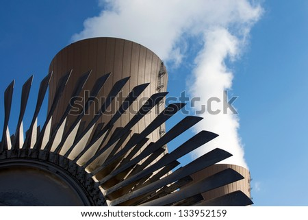 Steam turbine against nuclear power plant. Conceptual image of nuclear energy - stock photo