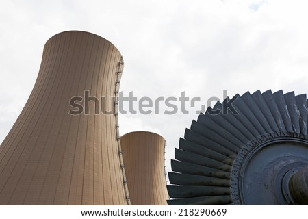 Steam turbine against nuclear power plant Conceptual image of nuclear energy