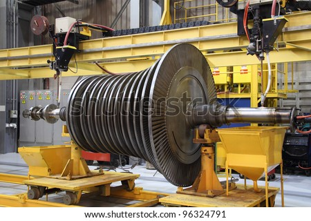 Steam turbine being worked on in an industrial manufacturing factory - stock photo