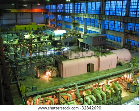 steam turbine during repair, machinery, pipes, tubes at a power plant, night scene - stock photo