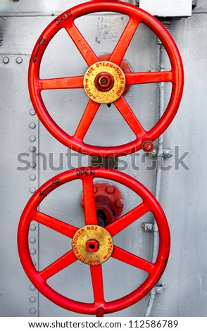 Steam valves from an old ship boiler.  Close up detail - stock photo