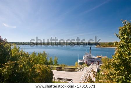 Steamboat at a pier. Calgary, Canada. - stock photo