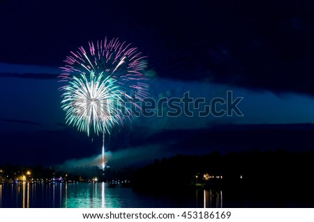 steamboat bay in east gull lake during fourth of july fireworks celebration over lake outside brainerd minnesota - stock photo