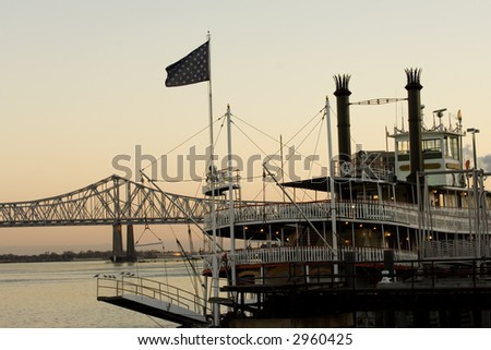 Steamboat on Mississippi river in New Orleans at sunset time - stock photo