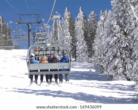 STEAMBOAT SPRINGS, COLORADO - JAN 30 -  Skiers ride the chairlift for another run  on Jan 30, 2010,  in Steamboat Springs, Colorado - stock photo