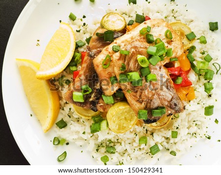 Steamed and baked sturgeon with stir-fry vegetables and rice. Shallow dof.  - stock photo
