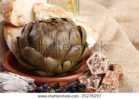 Steamed artichoke and sun dried tomato vinagrette - stock photo