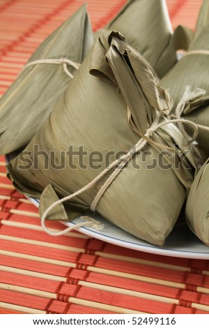 Steamed Chinese rice dumplings (zongzi) wrapped in bamboo leaves, filled with glutinous/sticky rice, pork, and mushrooms. These are eaten during the Dragon Boat Festival.