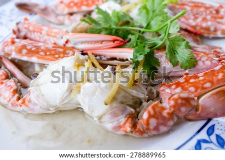 Steamed crab in Thai style served on a saucer - Selective focus - stock photo
