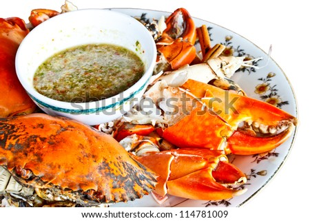 steamed crab with Thai spicy seafood sauce on white background - stock photo