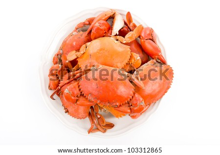 Steamed crabs on white plate - stock photo