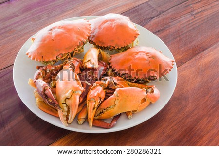 steamed crabs prepared on plate. - stock photo