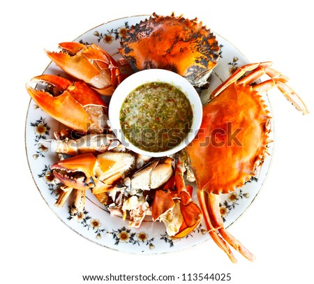 steamed crabs with spicy seafood sauce in Thai style on white background - stock photo