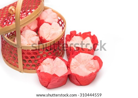 Steamed cupcake with red paper in red basket ,Dessert for chinese new year - stock photo