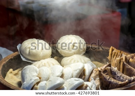 steamed dumpling Chinese dumplings being steamed on the traditional bamboo pan at Chinatown in Japan - stock photo