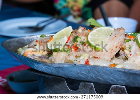 steamed fish, Chinese style steamed fish in spicy sauce - stock photo