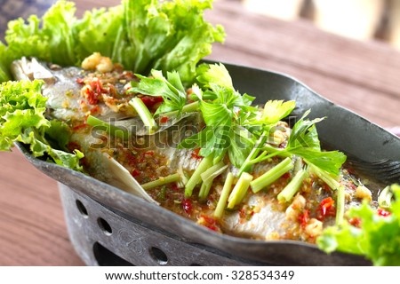 Steamed fish, Chinese style steamed fish in spicy sauce.