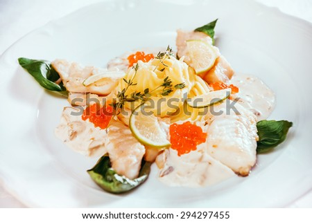 Steamed fish in lime dressing - stock photo