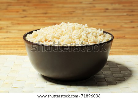 Steamed long rice in a brown bowl. - stock photo