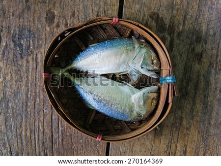 Steamed Mackerel fish on bamboo wicker basket - stock photo
