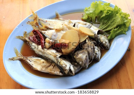 steamed mackerel fishes with ginger,garlic,and soy sauce on the  plate