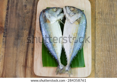 Steamed mackerel or tuna steamed on wooden background - stock photo