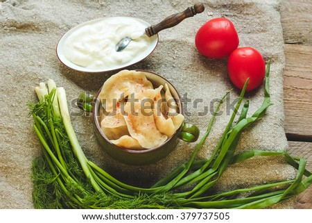 Steamed meat dumplings, traditional pelmeni or varenyky dish - stock photo