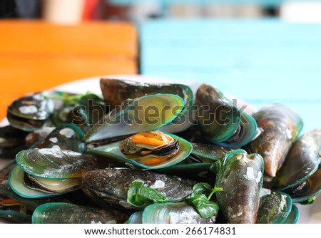 Steamed mussels with sweet basil and in Thai style - stock photo