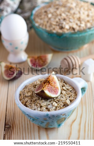 Steamed oatmeal with figs - stock photo