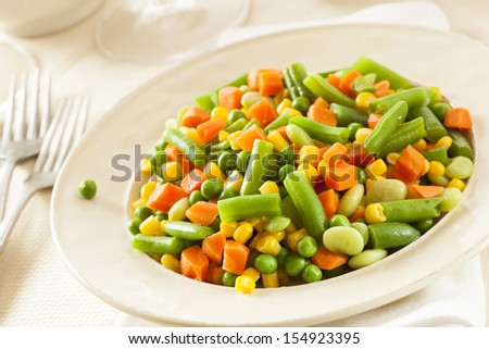 Steamed Organic Vegetable Medly  with Peas, Corn, Beans, and Carrots - stock photo