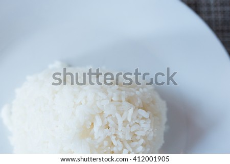 Steamed rice close-up. vertical top view - stock photo