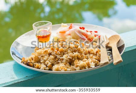 """Steamed rice fried with crispy crackling.Serve with a side of chili and fish sauce. This menu is named """"Fried check kg pig"""" - stock photo"""