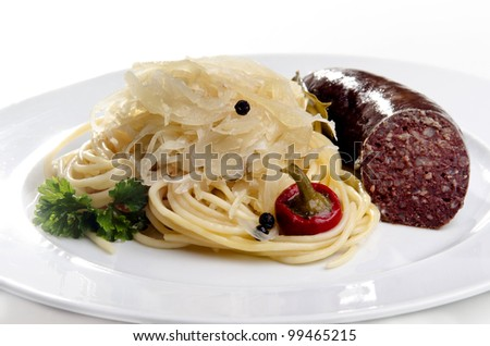 Steamed sauerkraut with grilled pork and spaghetti - stock photo