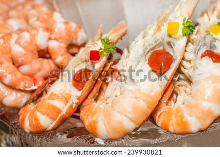 Steamed shrimps served on ice - stock photo