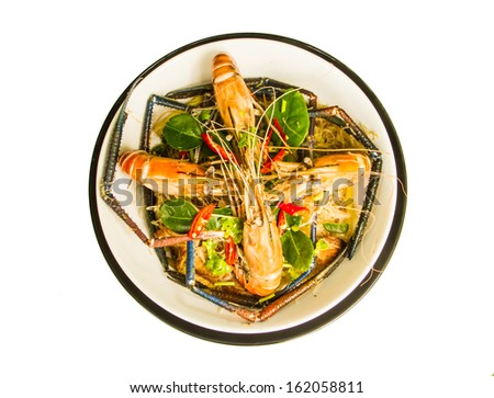 Steamed shrimps with glass noodle on the white background. - stock photo