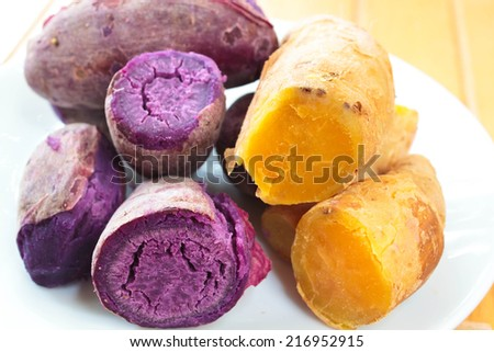 steamed sweet potato or cooked yams, yellow and purple. - stock photo