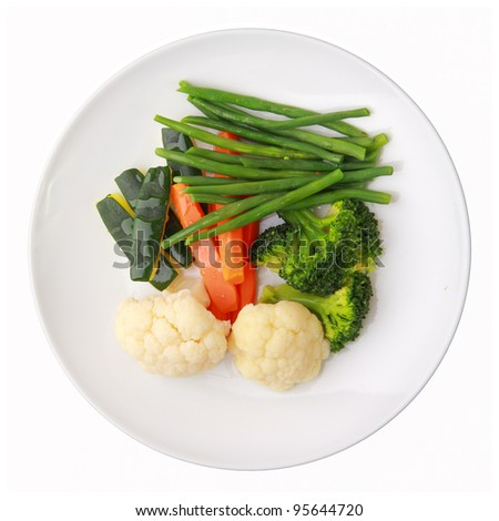 steamed vegetables of yellow, green and orange colors on white round dish isolated over white background. top view. - stock photo