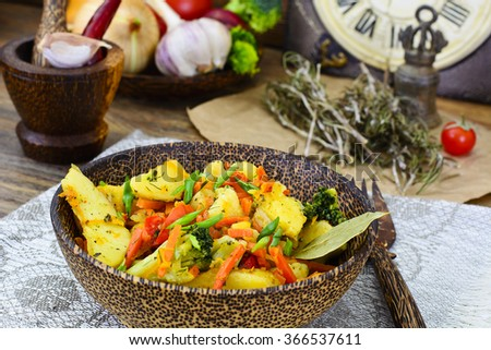 Steamed vegetables potatoes, carrots, corn, green beans, onion Studio Photo
