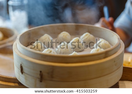 Steamed Xiaolongbao in The Bamboo Basket