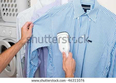 Steaming a shirt - stock photo
